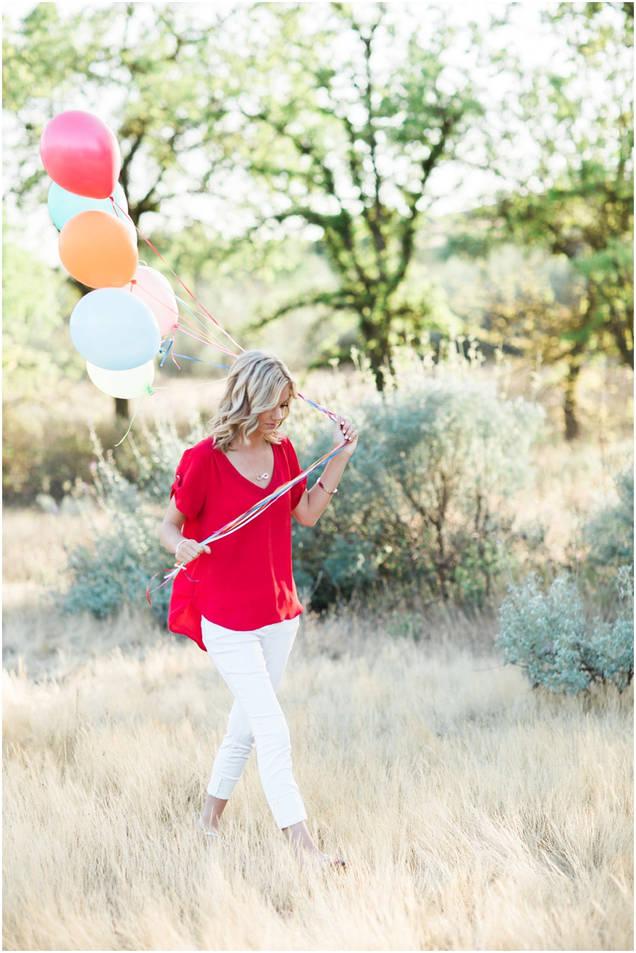 senior session with balloons