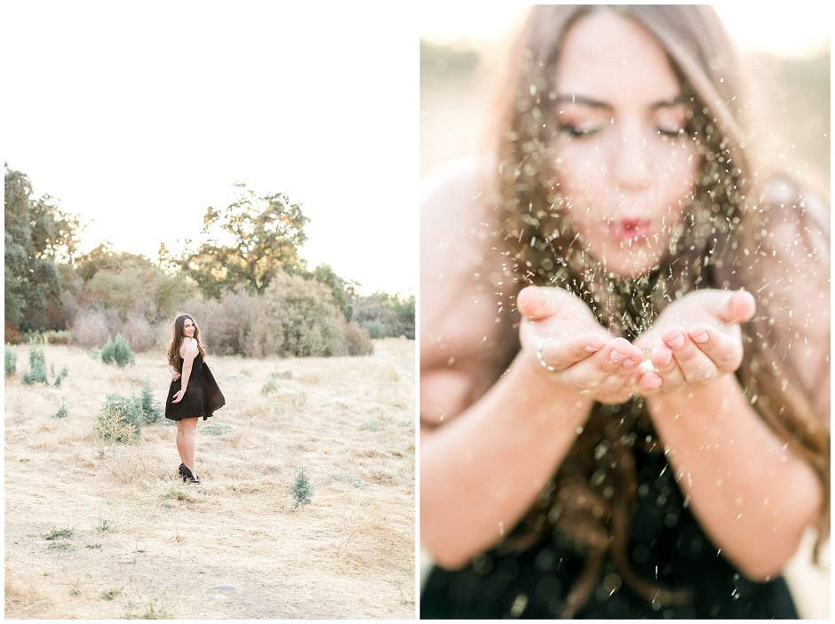 girl blowing gold glitter from her hands