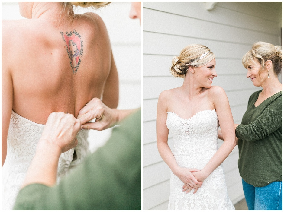 brides mom helping her into her dress