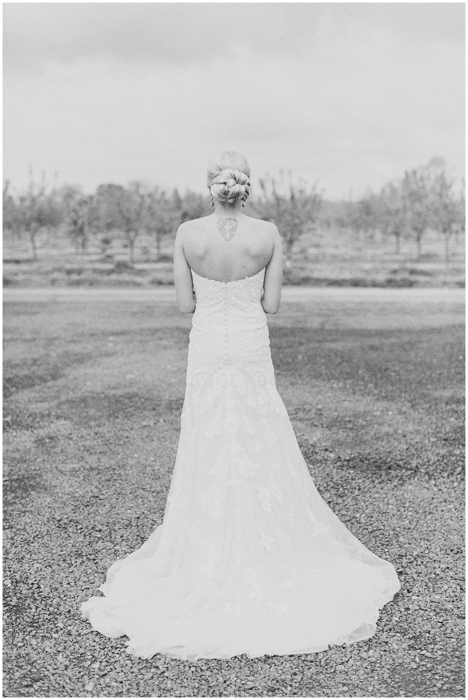 black and white portrait of a bride with a tattoo