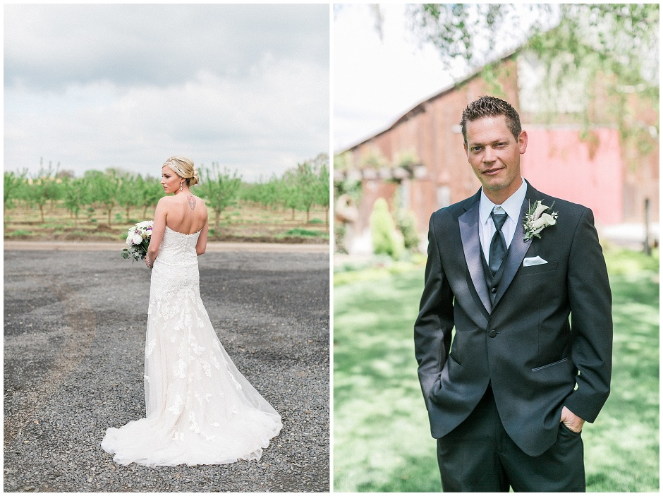 groom in a black tux in front of a barn