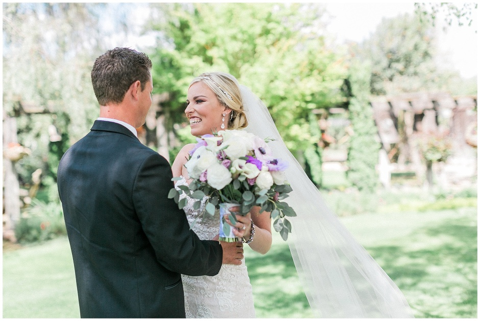 bride with beautiful white and purple bouquet