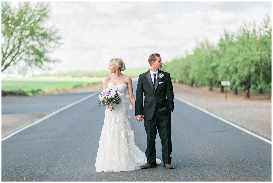 bride and groom in the middle of the road