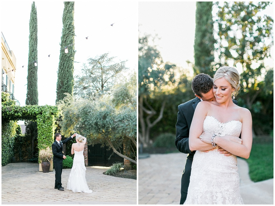 bride and groom dancing in a courtyard with cypress trees