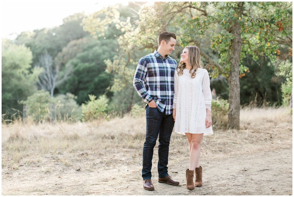 couple standing on a walking trail in the mountains
