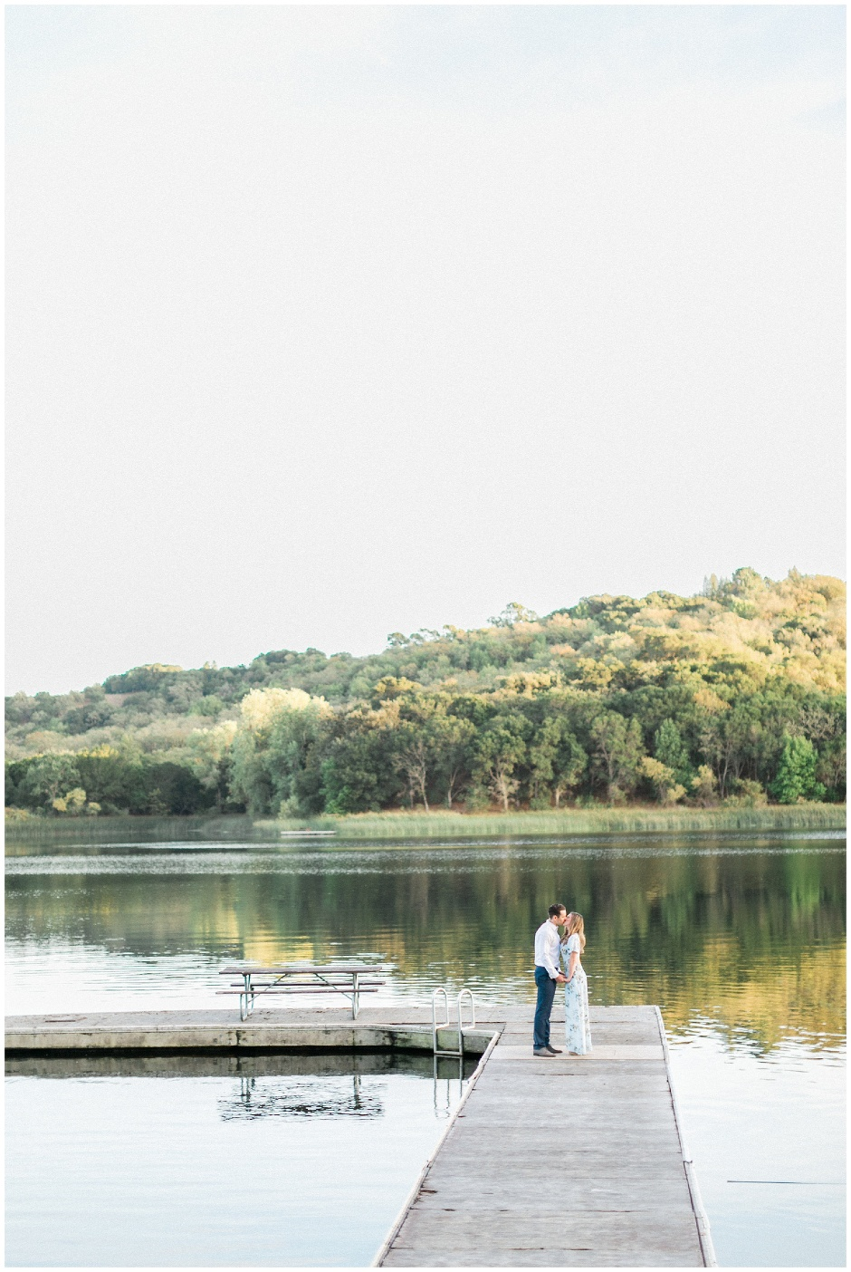 couple standing together on a boat dock