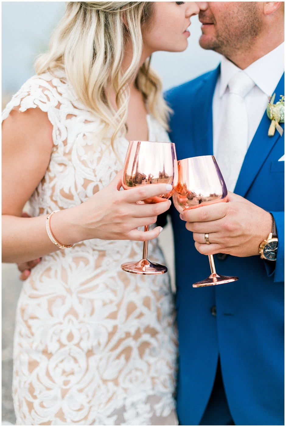 couple drinking out of copper wine glasses
