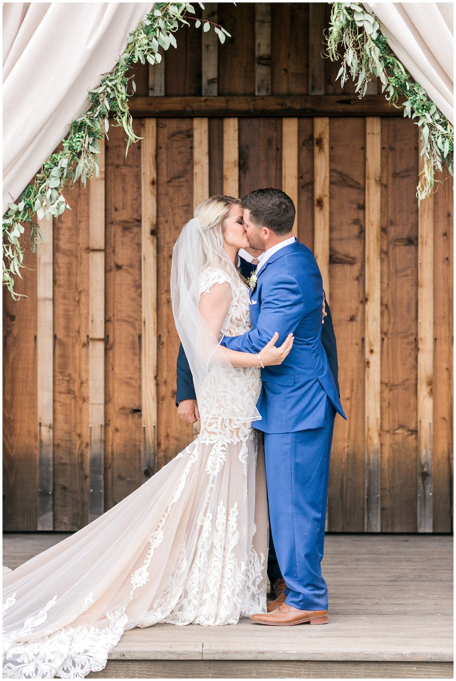 first kiss in front of a barn