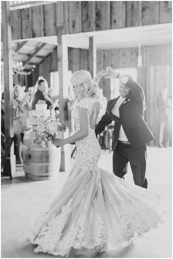 grand entrance of bride and groom to reception in black and white