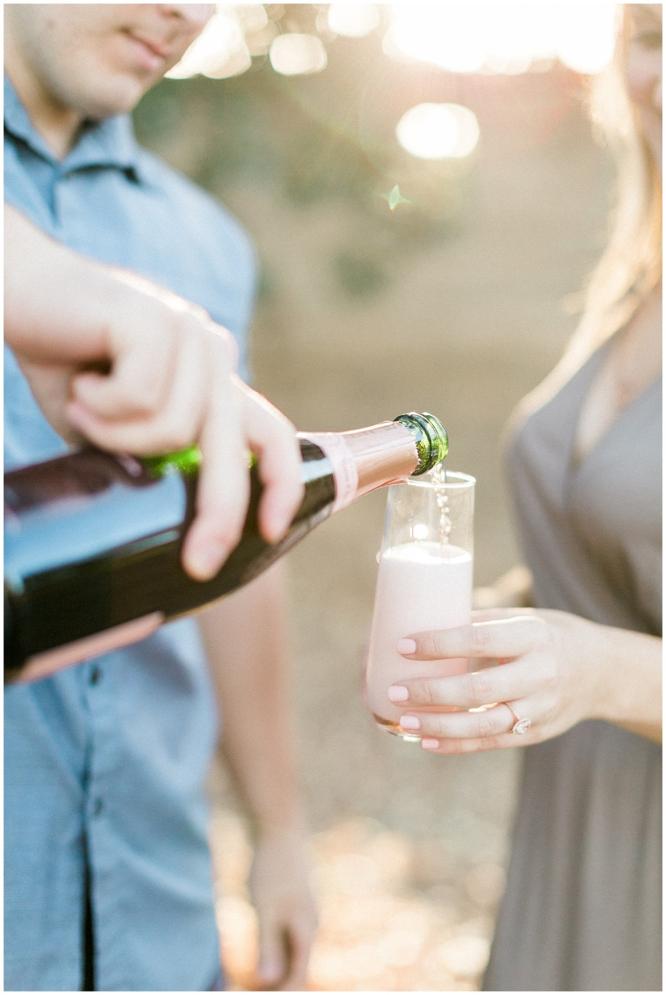 champagne being poured into a stemless champagne flute