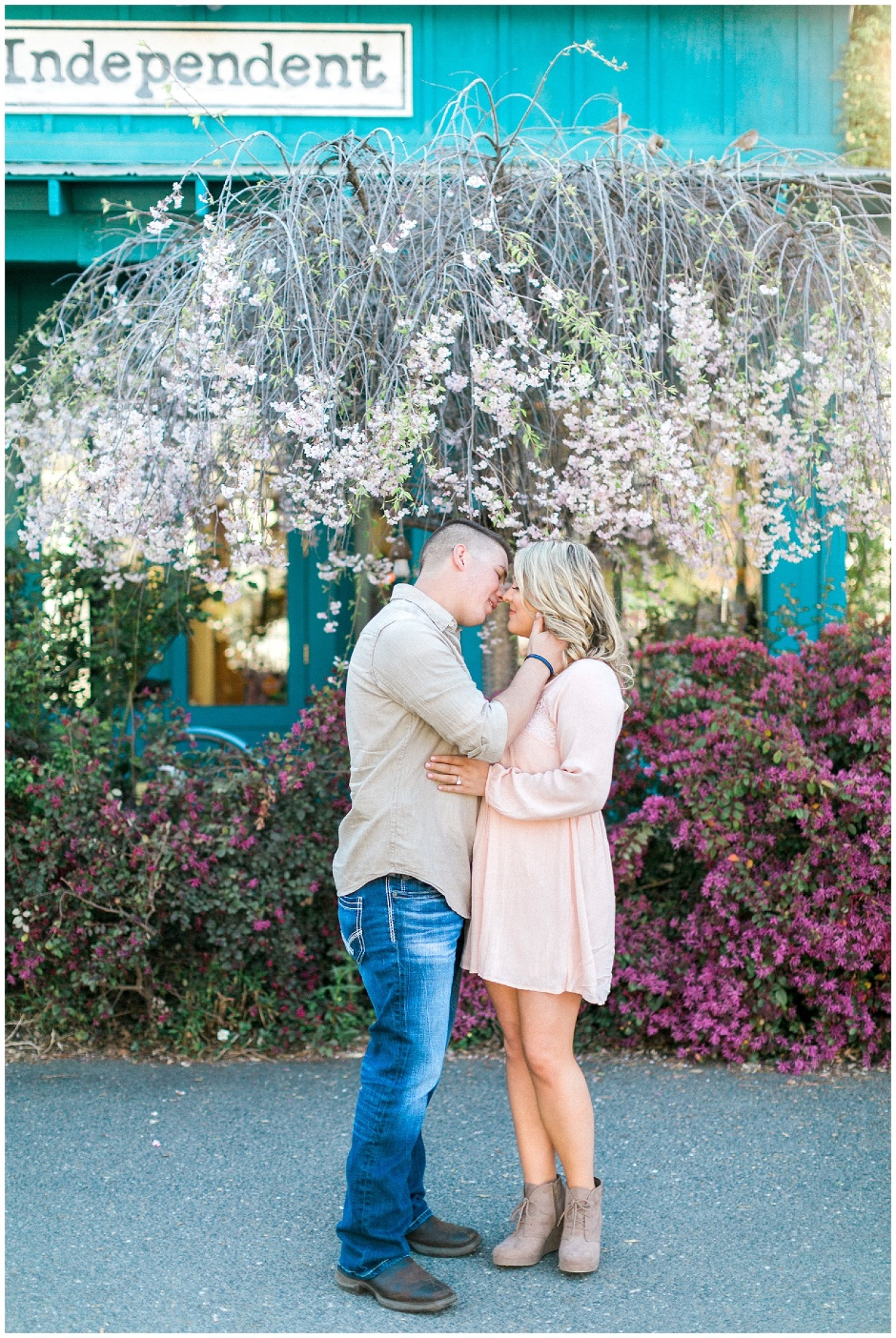 couple in front of colorful spring flowers