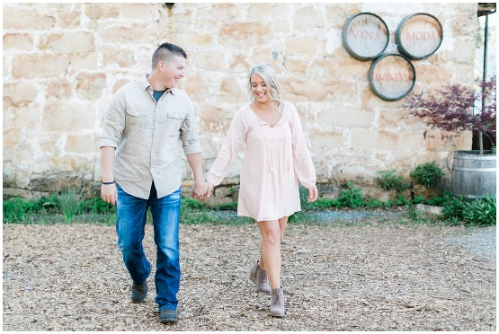 couple walking outside of a winery