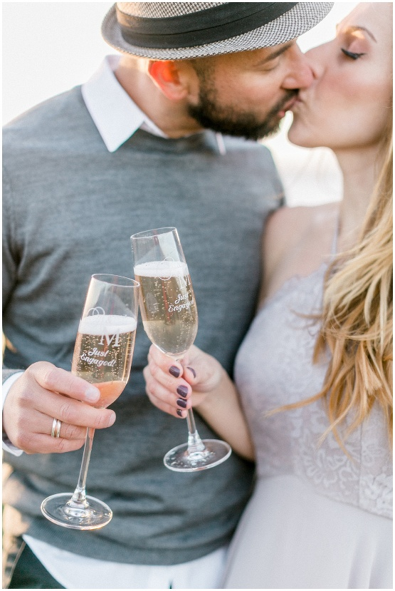 couple kissing with champagne glasses