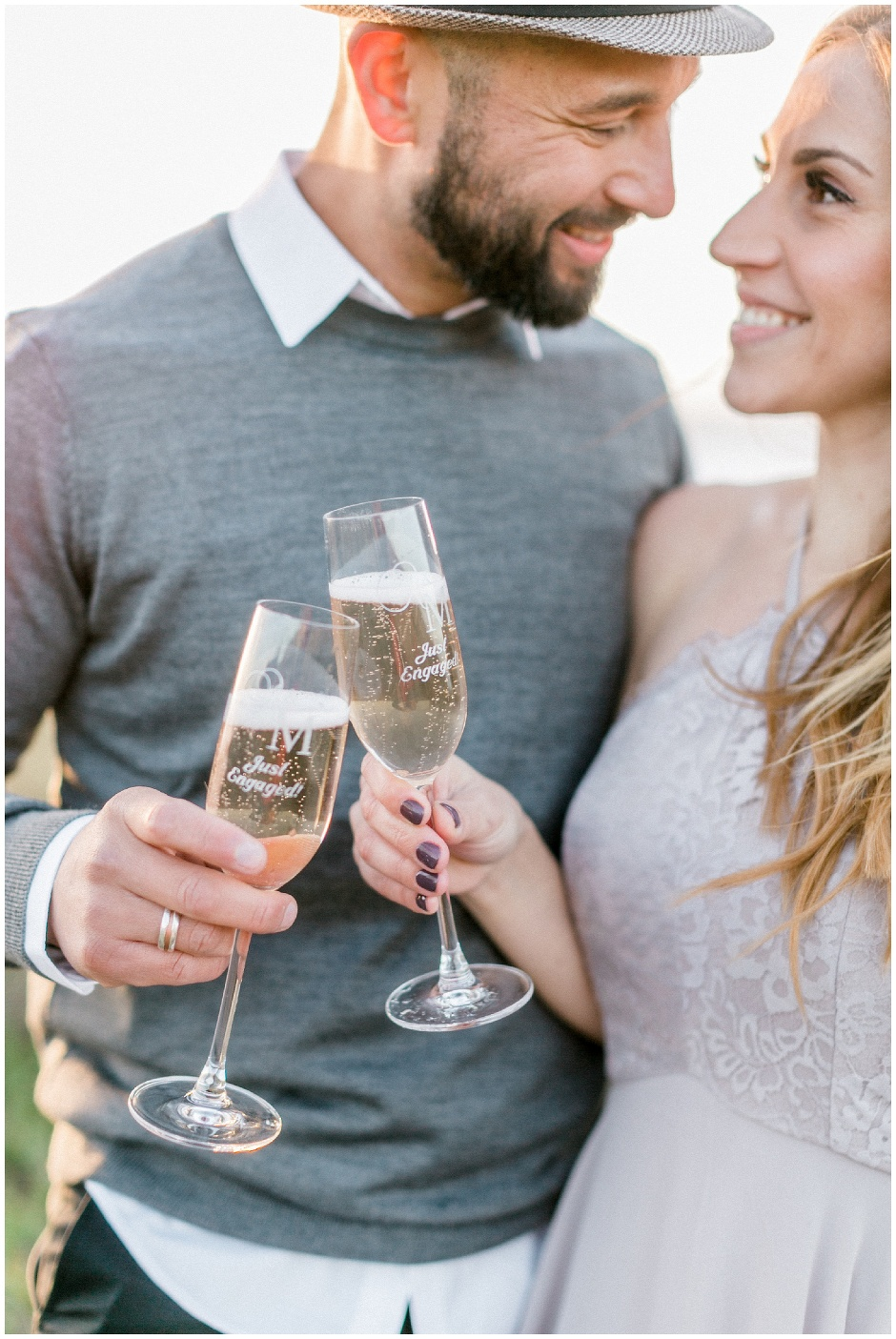 couple tapping glasses of champagne
