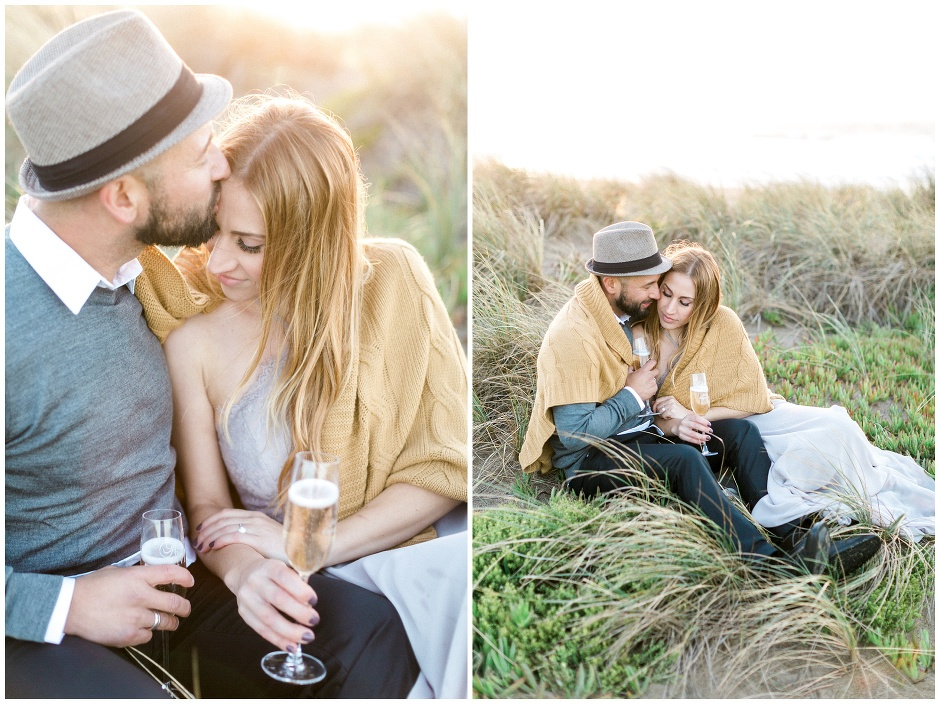couple surrounded by golden light on the beach