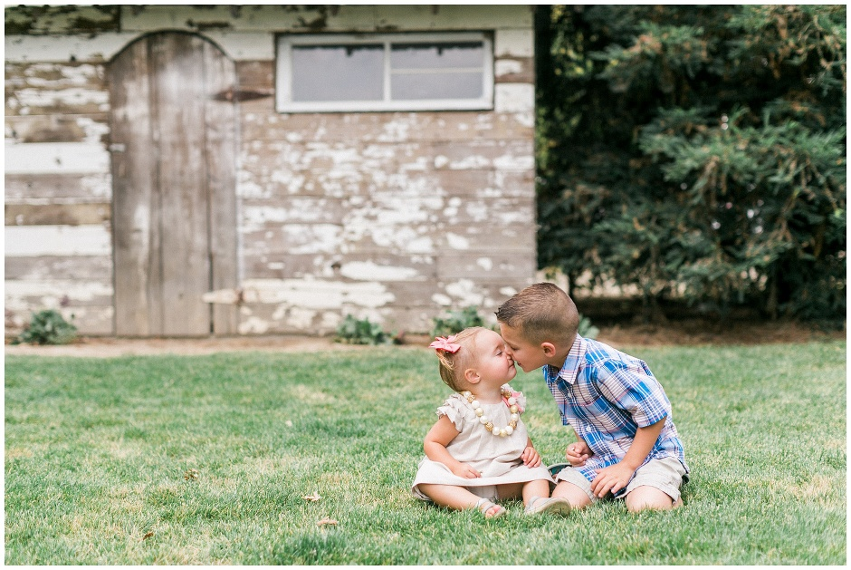 little boy kissing his sister