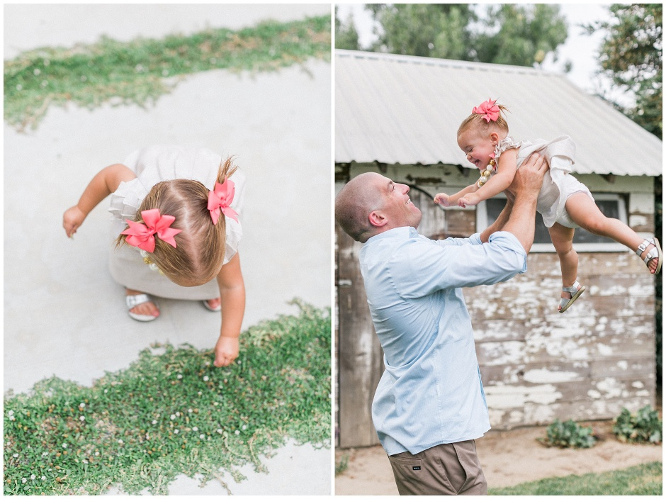 dad lifting his little girl up